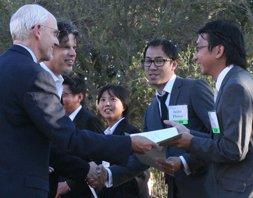 Paul G. Yock, Director of the Stanford Biodesign program, (left) and John congratulate members of DiaLock on their award.